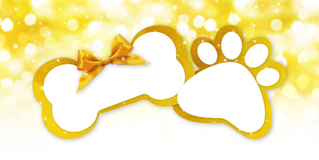 pets store gift card with bone and paw imprint shape golden ribbon bow on blurred christmas lights background blank template and copy space.