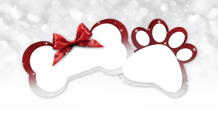 pets store gift card with bone and paw imprint shape red ribbon bow on blurred christmas lights background blank template and copy space.