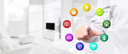 smart home automation hand touch screen with colored symbols on interior room background web banner and copy space template.