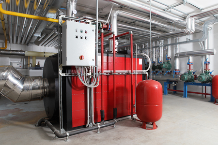 central heating and cooling system control in a boiler room. Banque d'images