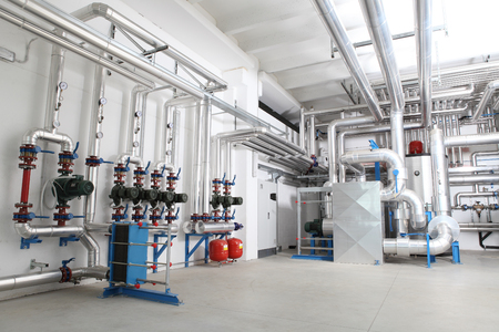 central heating and cooling system control in a boiler room. Stockfoto