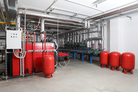 central heating and cooling system control in a boiler room