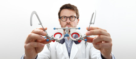optician hands with trial frame, optometrist doctor examines eyesight, front view isolated on white.