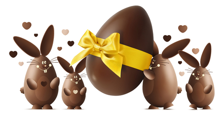 Chocolate Easter bunnies with egg and golden ribbon bow isolated on white background. Stock Photo