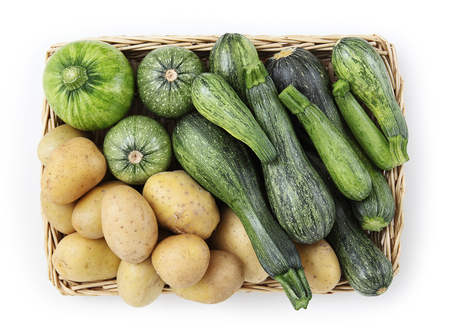 Basket of zucchini, and potatoes food top view isolated on white background.