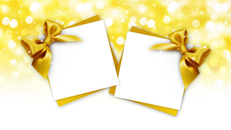 gift cards with golden ribbon isolated on white background.