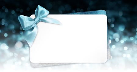 gift or greeting card with blue ribbon.