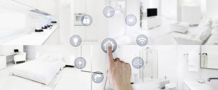 smart home control concept hand touchscreen pictogrammen met interieurs, woonkamer, keuken, slaapkamer en badkamer op onscherpe achtergrond. Stockfoto