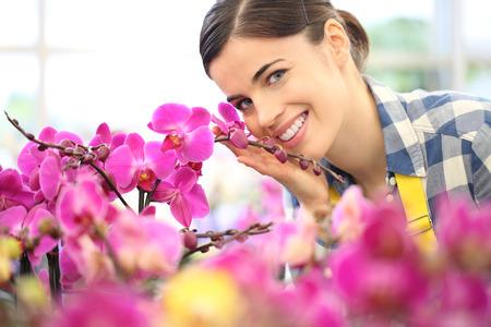 smiling woman in garden of flowers.