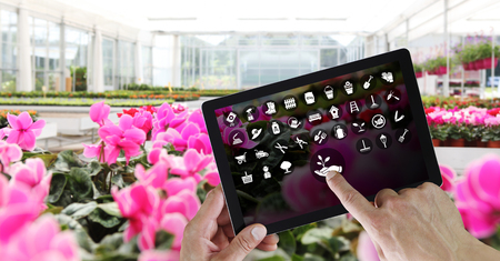 gardening equipment e-commerce concept, online shopping on digital tablet, hand pointing and touch screen Stok Fotoğraf