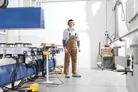 carpenter man works with wooden planks in the joinery, with computer numerical control center, cnc machine, isolated on a white background,