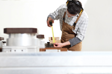 carpenter man works with wooden planks in the joinery, measure with meter, with computer numerical control center, cnc machine,  isolated on a white background