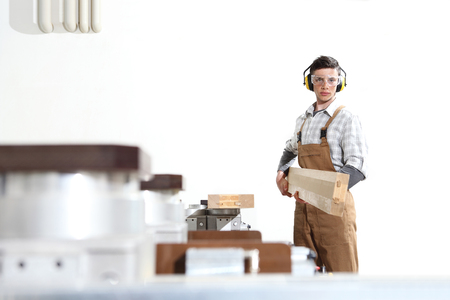 carpenter man works with wooden planks in the joinery, with computer numerical control center, cnc machine, isolated on a white background, Stock fotó