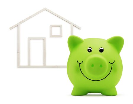 piggy bank with wooden house, green building and energy save concept.