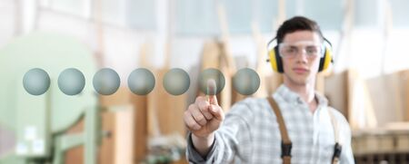 carpenter man touch screen with carpentry background. Stok Fotoğraf