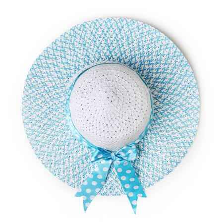 top view summer blue round straw hat with azure spotted bow ribbon isolated on white background.
