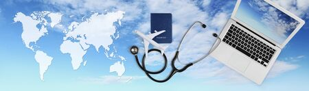 international medical travel insurance concept, stethoscope, passport, laptop computer and airplane on sky background banner with global map. Stockfoto