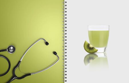 concept of healthy food and medical diet, paper notebook pages with fruit and kiwi juice isolated on white, copy space blank template. Stockfoto