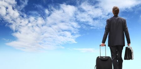 international business travel man, success concept, businessman walking with briefcase, isolated on blue sky background.