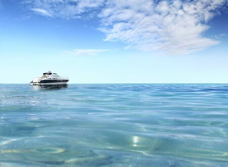 a luxury private motor yacht on tropical sea surface with blue sky clouds sunshine, empty background copy space. Stockfoto