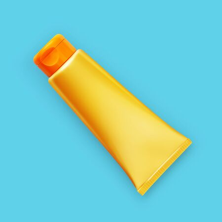 yellow and orange sunscreen tube isolated on blue background, top view. Stockfoto