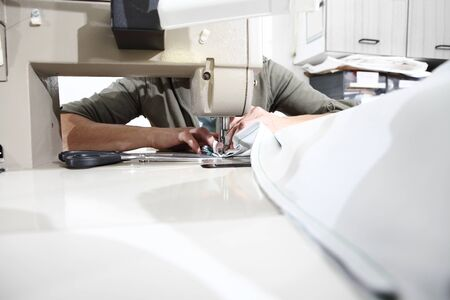 woman hands sewing machine, close up. Stockfoto