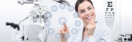 concept of eye examination, smiling woman with touch screen icons in optometrist office, optician diagnostic equipments on background.