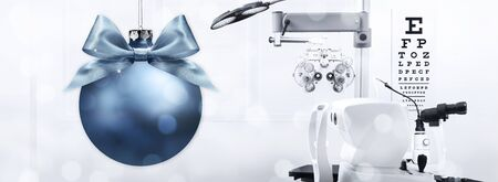 optometrist and optician merry christmas greeting concept, bow with eyes, eyes examination diagnostic equipment on background.