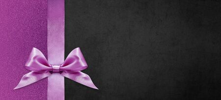 gift cards with pink ribbon bow Isolated on pink and black texture background, christmas and black friday template with copy space Archivio Fotografico