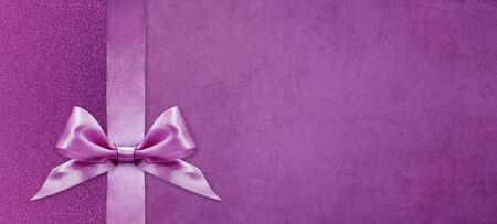 gift cards with pink ribbon bow Isolated on pink and purple texture background, christmas and greeting template with copy space