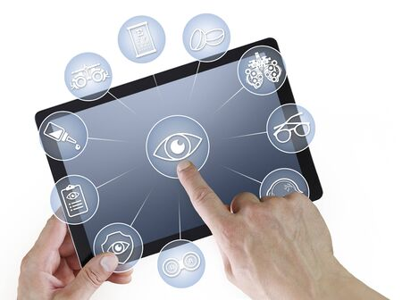 hands touch screen of digital tablet with ophthalmologist and optometrist icons symbols infographic, isolated on white background.