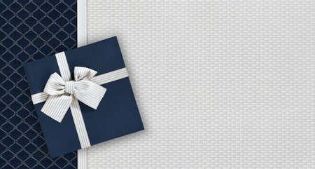 Gift card with gift box with ribbon and bow isolated on elegant blue and gray fabrics background, top view and copy space template, useful for father's day greeting
