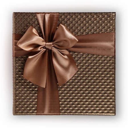 brown color gift box with shiny and elegant ribbon and bow isolated on white background, top view