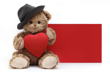 red gift card, funny teddy bear with hat and red heart isolated on white background, template with copy space