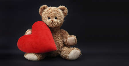gift card, teddy bear with red heart isolated on black background
