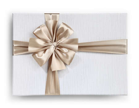gift box with golden ribbon bow isolated on white background, top view