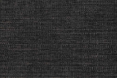 Fabric texture canvas. Cotton background. Detail close up for dress or other modern fashion textile print. Gray and black textured design.