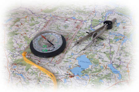 Compass and compasses on a map