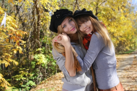 2  young girls are having fun in the forest photo