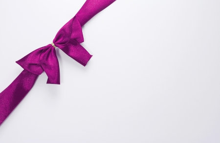 purple ribbon with bow with tails isolated on white background photo