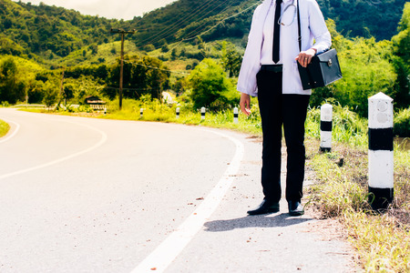 tosiendo: Asia young docter are standing at rural road .Community Health and Development Hospital In Remote Areas Development Fund Concept.