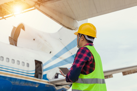 Engineers are checking the repair aircraft,working people,Concept maintenance of aircraft. Stock Photo