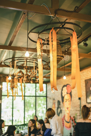 Warm lighting coming out from beautiful lamps on ceiling,ropes and wood,Hanged from the ceiling . 写真素材