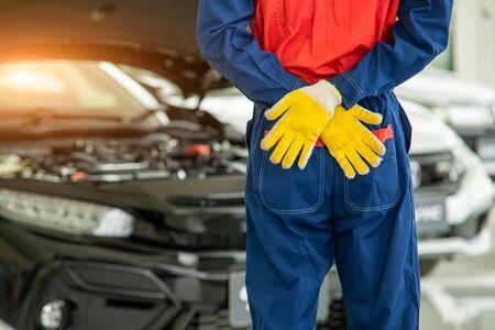 Portrait of mechanic standing in repair shop,Service concept,Repair of machines,Repair specialist,Technical maintenance.
