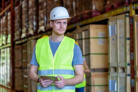 Technician works in merchandise trade in logistics,Warehouse workers.