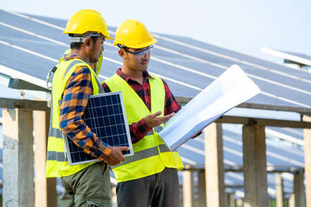 Engineer working and checking at solar power station,Climate change and renewable energy,renewable energy friendly management systems concept. Stockfoto
