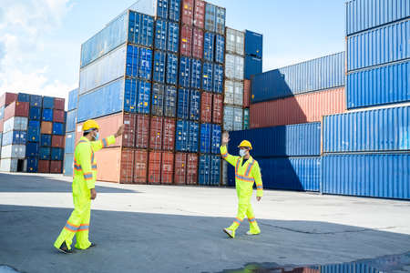 Foreman and dock worker staff are shaking elbows greeting each other at cargo container,Coronavirus epidemic,Elbow greeting style,Coronavirus prevention,Social distancing concept,Stop coronavirus outbreak. Reklamní fotografie