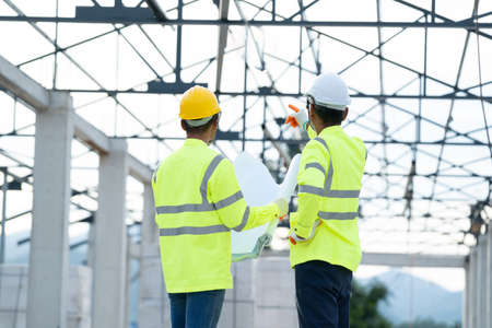 Construction manager and architect working on building site. Stockfoto