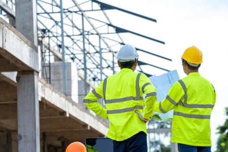 Civil engineers and architect inspecting construction site. Stock fotó