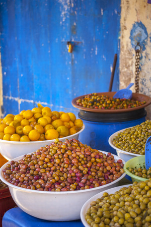 orintal: Olives at the marked, green, blue wall Stock Photo